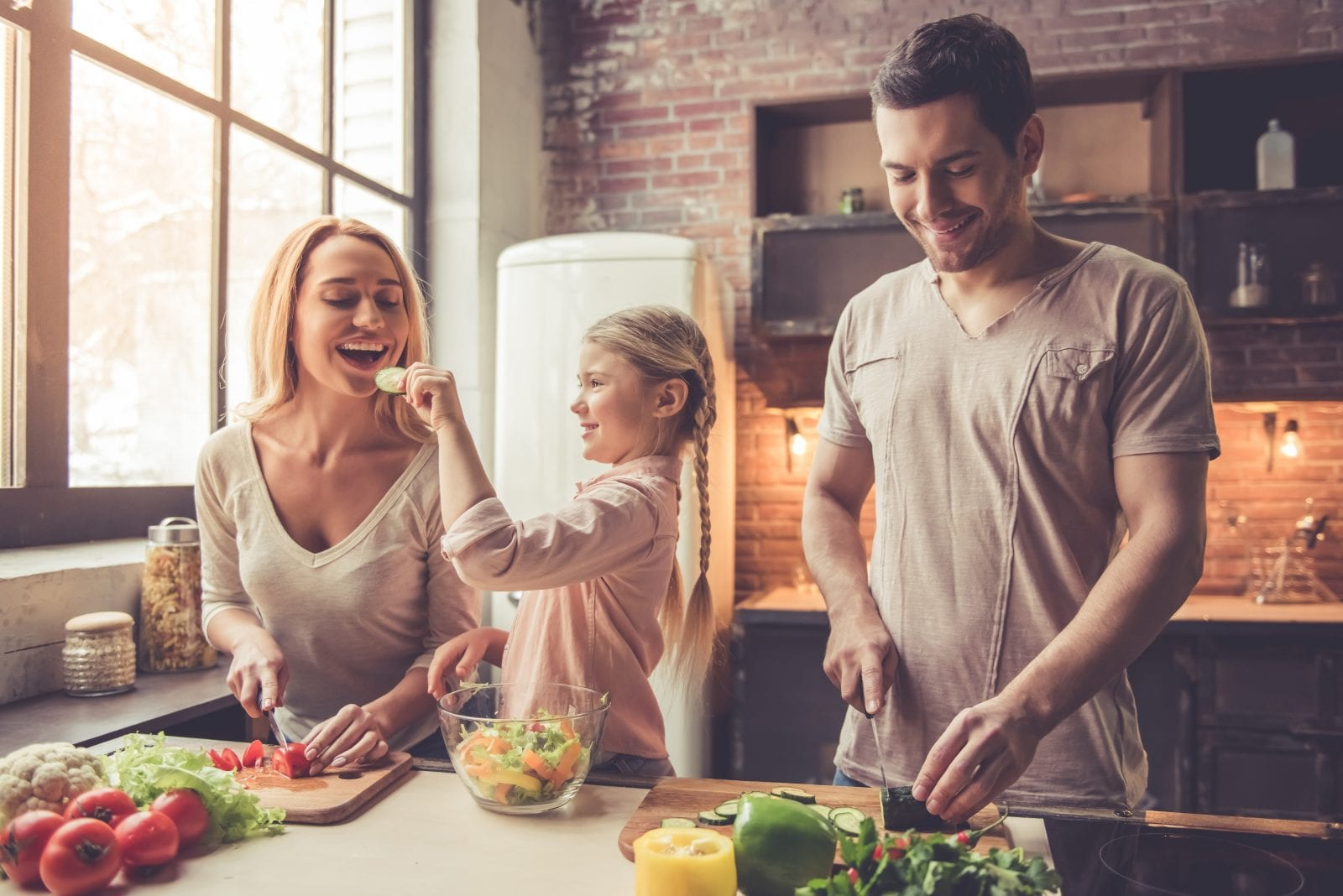 Young family cooking healthy